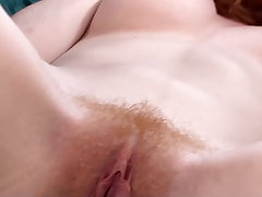 Hairy pussy Abby Rain uses a vibrator involving orgasm
