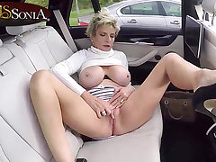 Busty Lady Sonia masturbates in the backseat be expeditious for her car